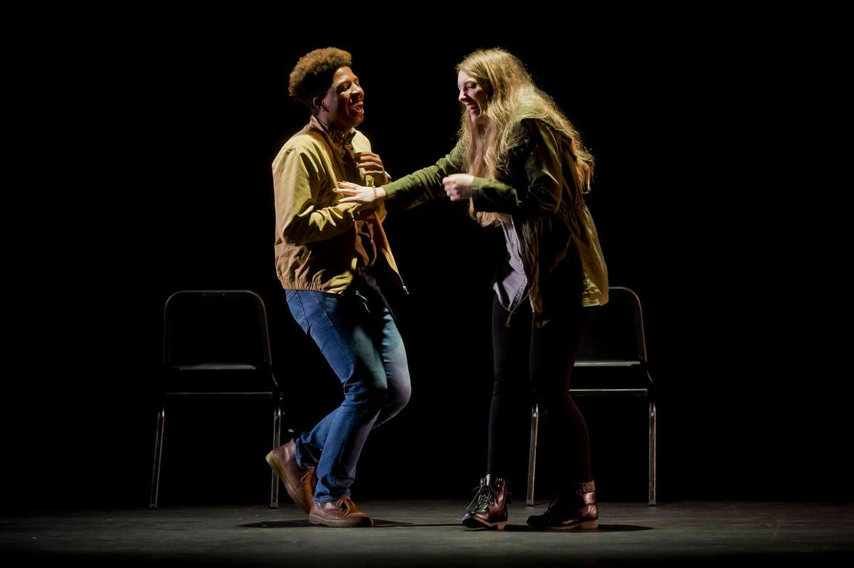 Donte Green, left, and Brianne Dolney act out a scene during a dress rehearsal for Passion Theatre's production of Constellations on Tuesday at Bullock Creek High School. (Katy Kildee/kkildee@mdn.net)