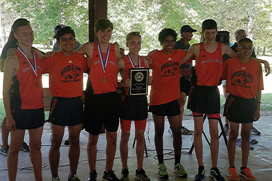 The Bridgeland High School boys cross country team celebrates its District 20-5A team runner-up finish at Camp Misty Meadows in Conroe on Oct. 12. Pictured are: Randy Smith, Dominic Campbell, Zachary Nelson, Cody Gambrell, Reylen Diaz, Jorge Cantu and Enrique Gonzalez. Photo: Bridgeland, Cy-Fair ISD