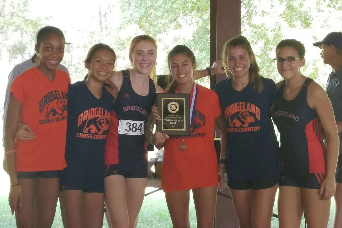 The Bridgeland High School girls cross country team celebrates its District 20-5A team third-place finish at Camp Misty Meadows in Conroe on Oct. 12. Pictured are: Natalie Mason, Athena Reyna, Haley Williams, Eliana Lake, Ashley Chanthacone and Grace Rauch.