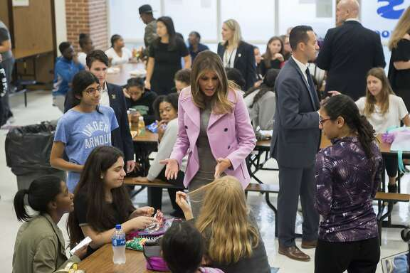 First lady Melania Trump chats with students while visiting Orchard Lake Middle School in West Bloomfield, Mich., Monday, Oct. 23, 2017. (David Guralnick/Detroit News via AP)