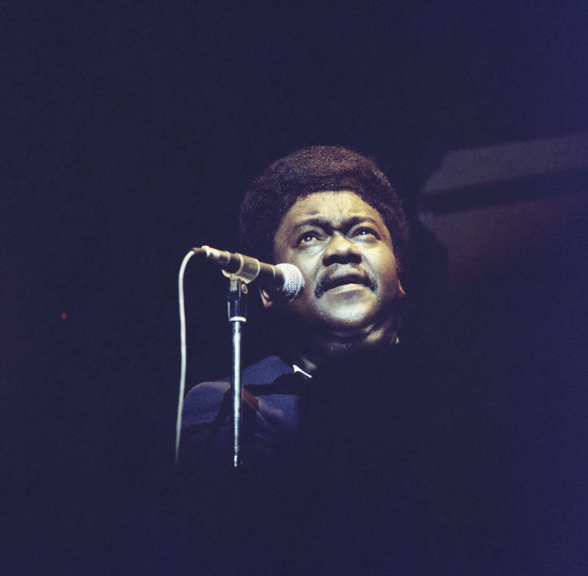 Fats Domino performs on stage in the early 1970's. (Photo by David Redfern/Redferns)