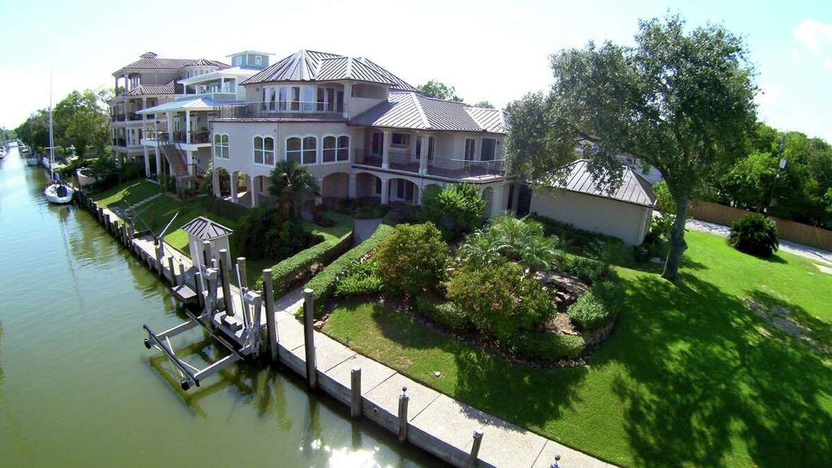 This waterfront Kemah property is slated to hit the auction block soon.