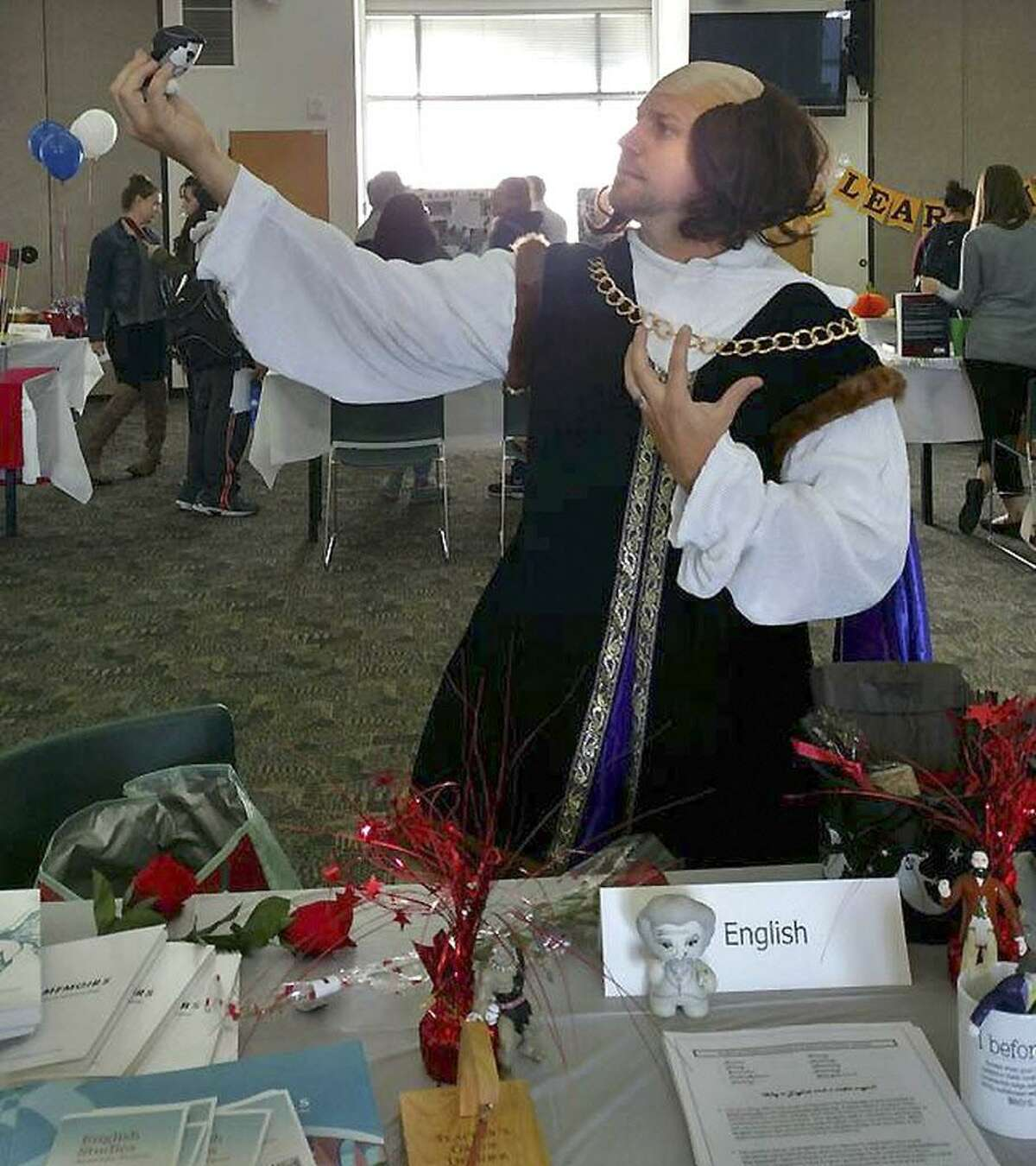 Middlesex Community College hosted a festive career and resource fair for local college and high school students to explore specialized job and program options Oct. 11. Exhibits were entered into a competition for the best display. Here, an English student shows off his dramatic skills.