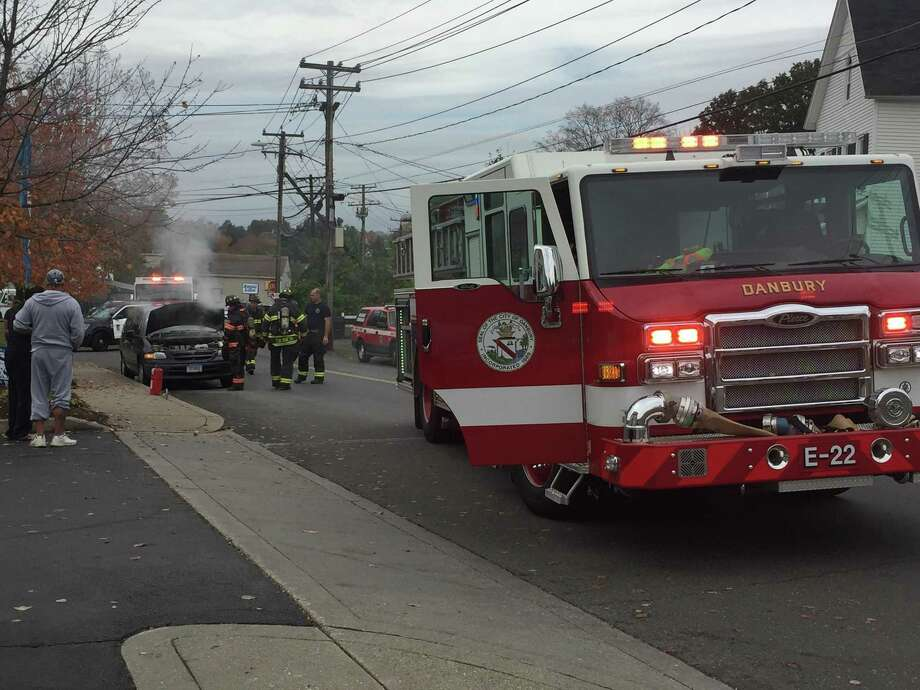 Firefighters put out a car fire Wednesday morning on Oct, 25, 2017 at the intersection of South and Triangle streets. There will be delays in the area until the vehicle is towed. Photo: Danbury Fire Department Photo