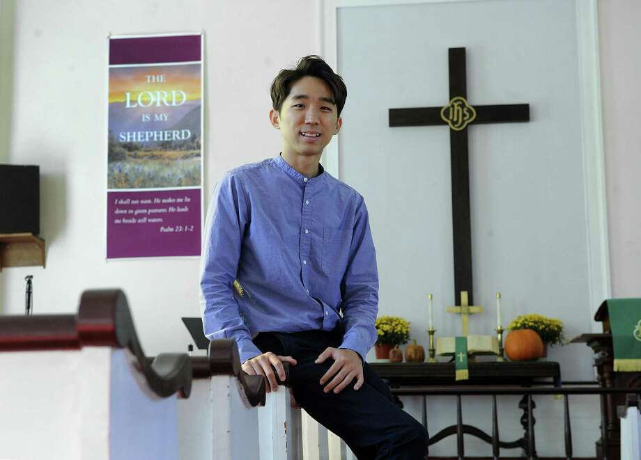Jacob Eun, 26, came to the Gaylordsville United Methodist Church in New Milford by way of the University of Connecticut, Drew Theological School and Princeton Theological Seminary. Photo: Carol Kaliff / Hearst Connecticut Media / The News-Times