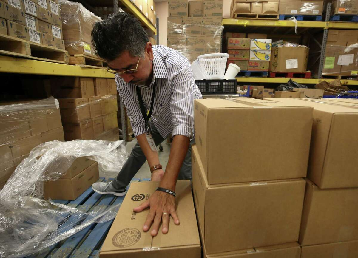 Jesse Mendoza, 62, stacks boxes at the Second Mile Mission Center, one of many Houston charities that faced a huge demand for services after Hurricane Harvey.