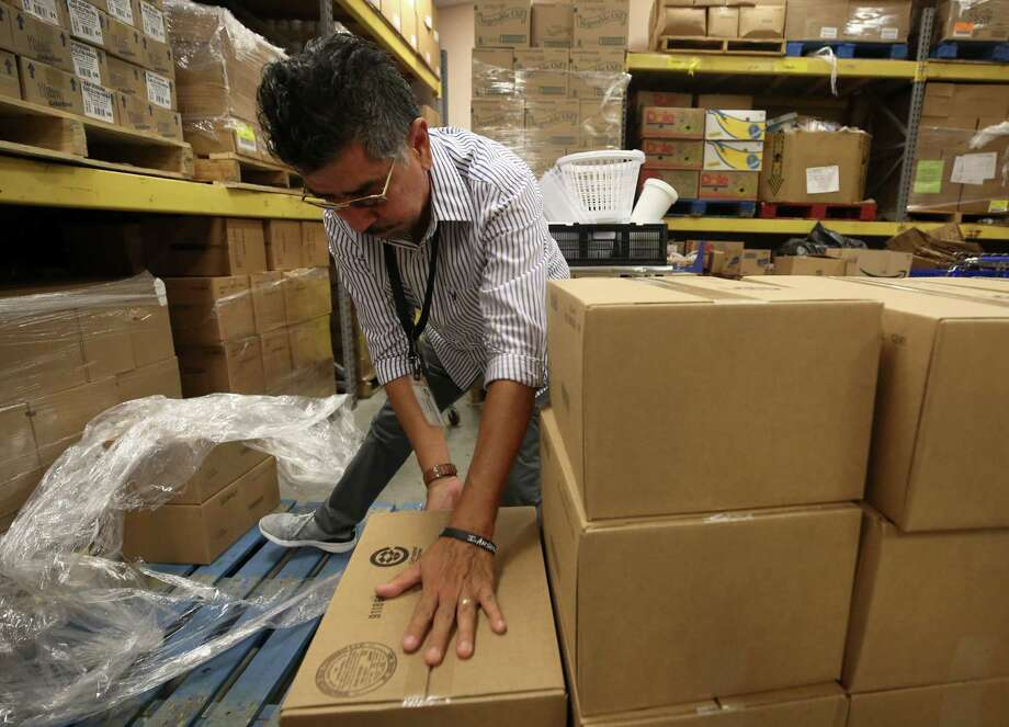 Jesse Mendoza, 62, stacks boxes at the Second Mile Mission Center, one of many Houston charities that faced a huge demand for services after Hurricane Harvey. Photo: Godofredo A. Vasquez, Houston Chronicle / Godofredo A. Vasquez
