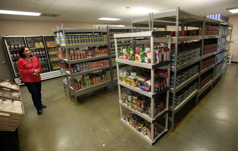 Sheena Abraham, director of advancement at the Second Mile Mission Center, said donations kept the pantry stocked to serve Harvey victims. Photo: Godofredo A. Vasquez / Godofredo A. Vasquez