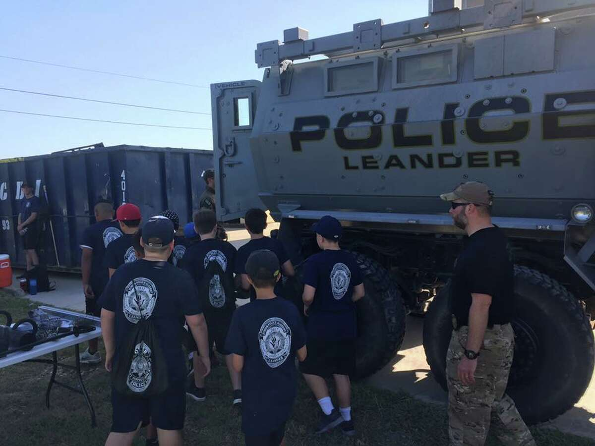 Leander police show their MRAP to children in this photo posted on Facebook by the police department.