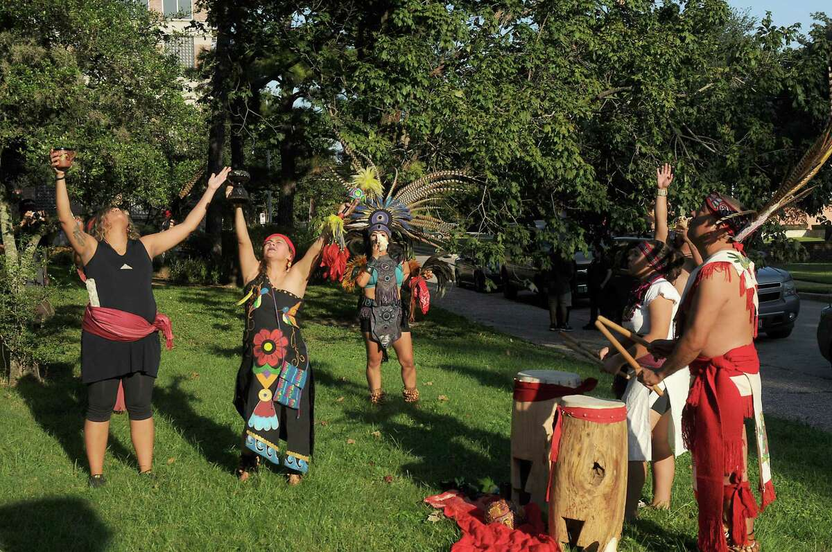Members of Danza Azteca Taxca Yoloztl perform traditional dance.