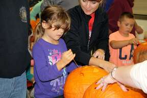 Bad Axe Elementary second graders got together in the elementary cafeteria Tuesday night to carve their Halloween pumpkins. Parents helped with the carving, and the students were able to have cider and doughnuts afterwards.