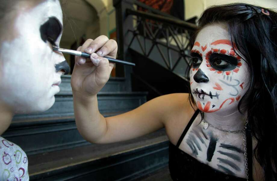 "Don't be afraid to get your ""sugar skull"" ghoul face on at the Día de los Muertos Festival at MECA Houston this weekend. Photo: Melissa Phillip, Staff / © 2011 Houston Chronicle"