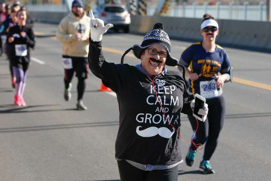 Runners made their way over the Arrigoni Bridge from Portland to Middletown during last year's Hartford Marathon Movember 5K. Photo: File Photo
