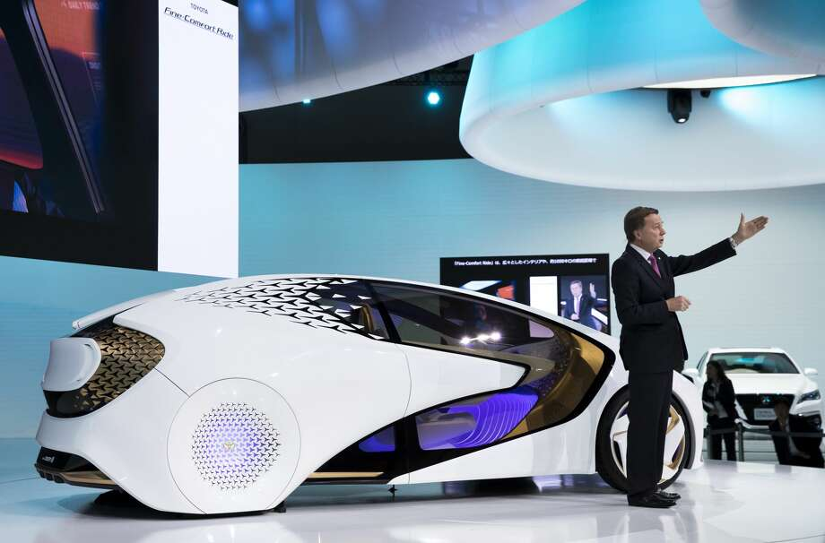 TOKYO, JAPAN - OCTOBER 25:  Toyota Motor Corp. Executive Vice President Didier Leroy, speaks in front of the TOYOTA Concept-i series concept vehicles during the Tokyo Motor Show at Tokyo Big Sight on October 25, 2017 in Tokyo, Japan. The 45th edition of Tokyo Motor Show, which domestic and international automobile manufacturers exhibit their latest products, continues until November 5. (Photo by Tomohiro Ohsumi/Getty Images) Photo: Tomohiro Ohsumi/Getty Images