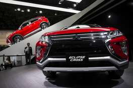 TOKYO, JAPAN - OCTOBER 25: Mitsubishi Motors Corp.'s eEclipse Cross sports utility vehicles are displayed during the Tokyo Motor Show at Tokyo Big Sight on October 25, 2017 in Tokyo, Japan. The 45th edition of Tokyo Motor Show, which domestic and international automobile manufacturers exhibit their latest products, continues until November 5. (Photo by Tomohiro Ohsumi/Getty Images)