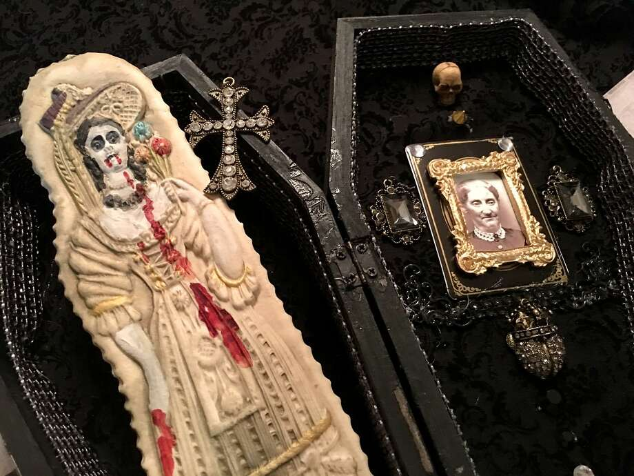 Carol Jeske, owner of Carol's Hand Crafted Cookies, collects antique cookie molds. This cookie came from a mold for a fair lady and was given undead alabaster skin and fangs, streaks of crimson dribbling down her bodice. Photo: Courtesy Carol Jeske