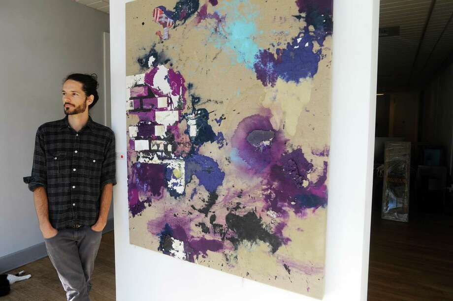 Artist James Gortner poses beside one of his pieces inside the Fernando Luis Alvarez Gallery on Bedford Street in downtown Stamford, Conn. on Monday, Oct. 23, 2017. Photo: Michael Cummo / Hearst Connecticut Media / Stamford Advocate