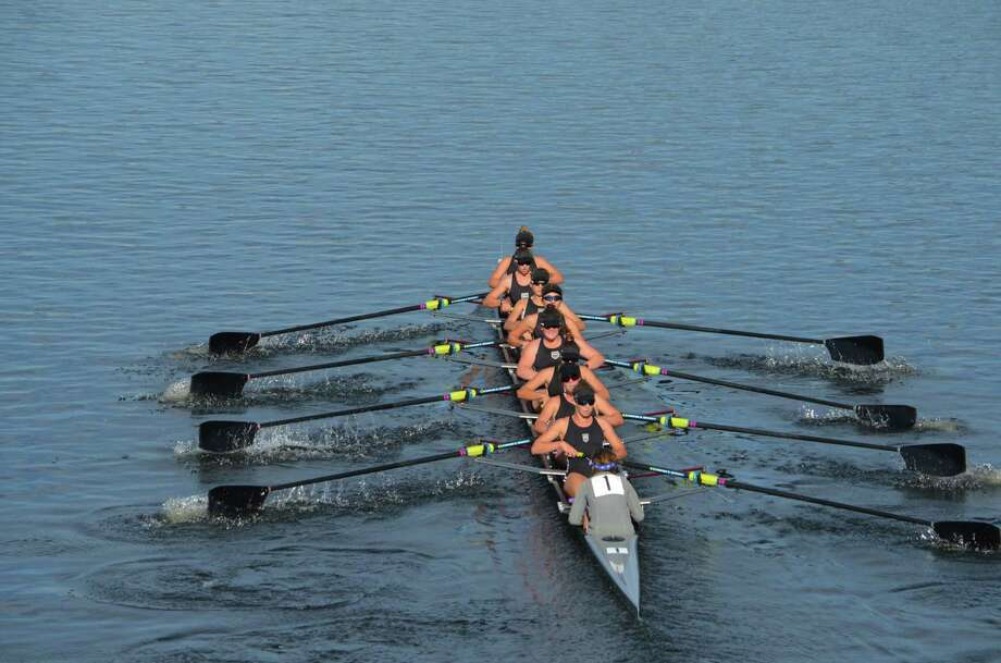 The SRC women's youth 8+ races to a gold-medal finish at the Head of the Charles Regatta, the crew's fourth win in a row. New Canaan rowers include: second from back, Justine McGuire; fifth from back, Sydney Kend; and second rower from front, Caitlin Esse. Photo: Contributed Photo / New Canaan News contributed