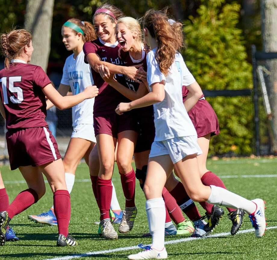 Members of the St. Luke's girls soccer team celebrate their 4-0 win last Satuday. Photo: Contributed Photo / New Canaan News contributed