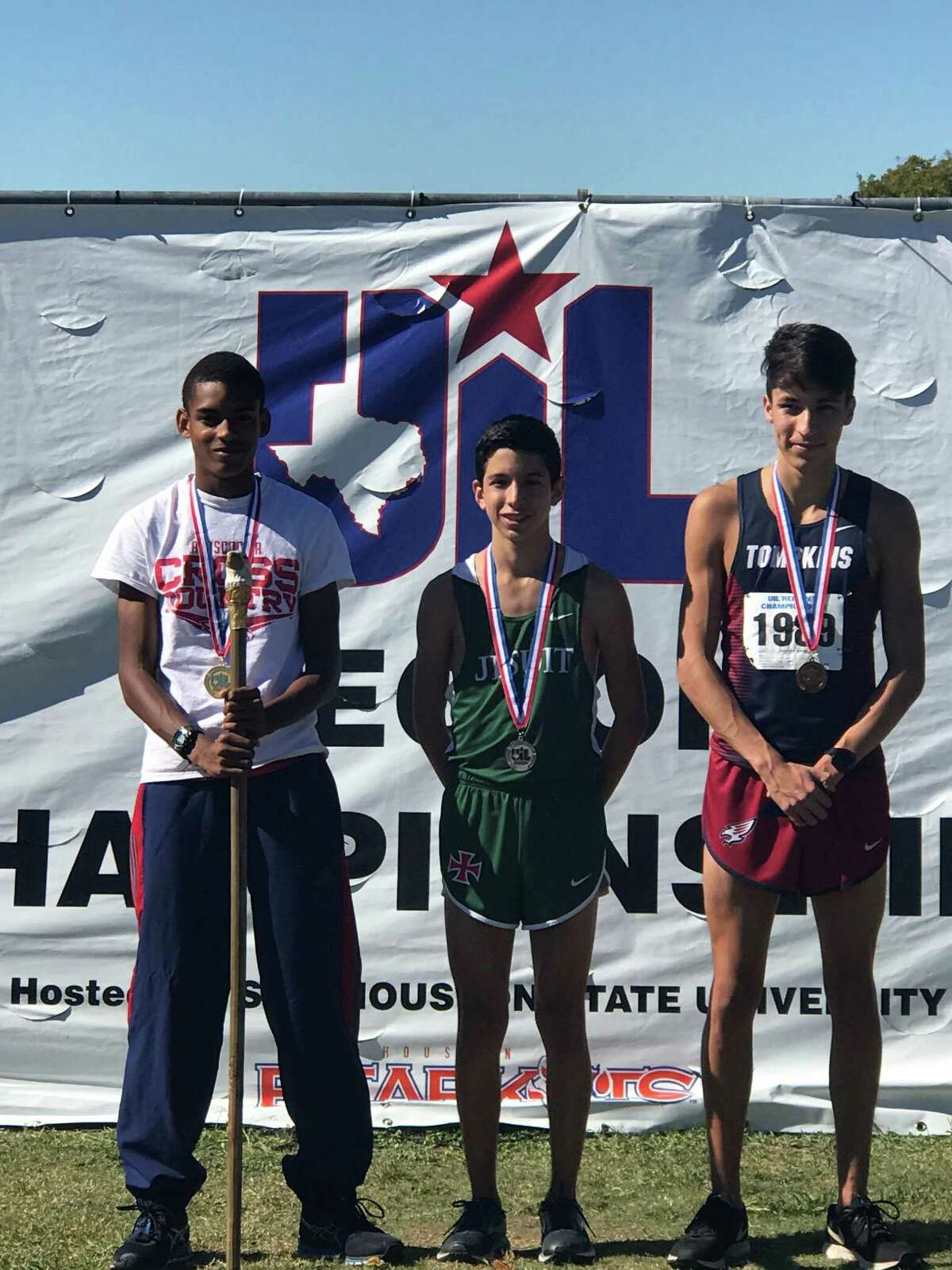 Atascocita senior Worthington Moore (left), freshman Avery Clover (center), and senior Ben Maldinado (right) qualified for the state cross country meet out of the region meet