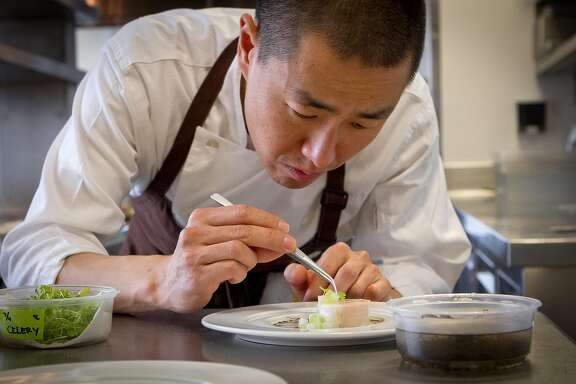 Chef Corey Lee prepares Chicken with Black Moss and Mountain Yam at Benu restaurant in San Francisco, Calif., on Friday, February 3, 2012.