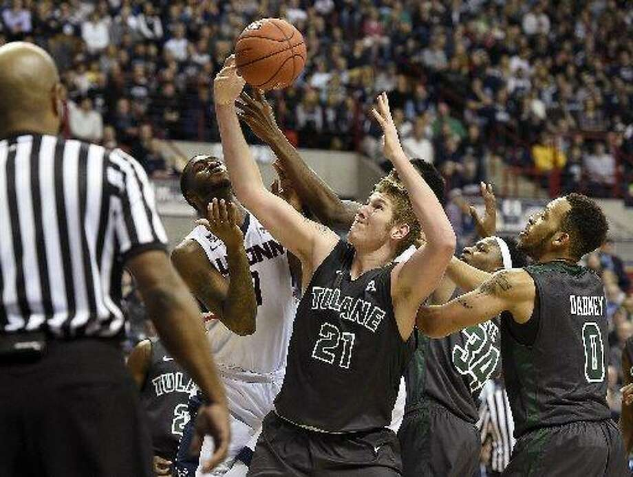 Tulane's Dylan Osetkowski (21) gets a hand on a rebound before Connecticut's Phillip Nolan (1) during the second half at Gampel Pavilion in Storrs, Conn., on Sunday, Feb. 22, 2015. UConn won, 67-60. Osetkowski transferred to Texas and is eligible to play this season. Photo: John Woike /Hartford Courant