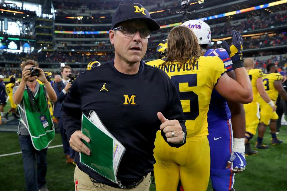 Head coach Jim Harbaugh of the Michigan Wolverines exits the field after the Michigan Wolverines beat the Florida Gators 33-17 at AT&T Stadium on September 2, 2017 in Arlington, Texas. Photo: Tom Pennington/Getty Images