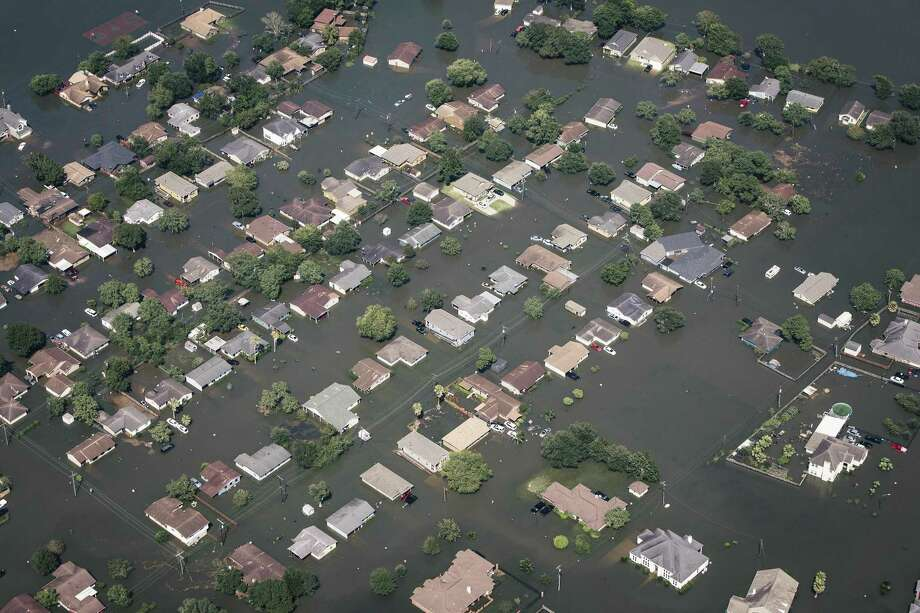 Floodwater surrounds homes in Beaumont, Texas, about 70 miles east-northeast of Houston, Aug. 31, 2017. With most roads in and out of the area under water, and the Neches River still rising, federal officials are trying to get enough bottled water into Beaumont to prevent a health crisis. (Alyssa Schukar/The New York Times) Photo: ALYSSA SCHUKAR, STR / NYT / NYTNS