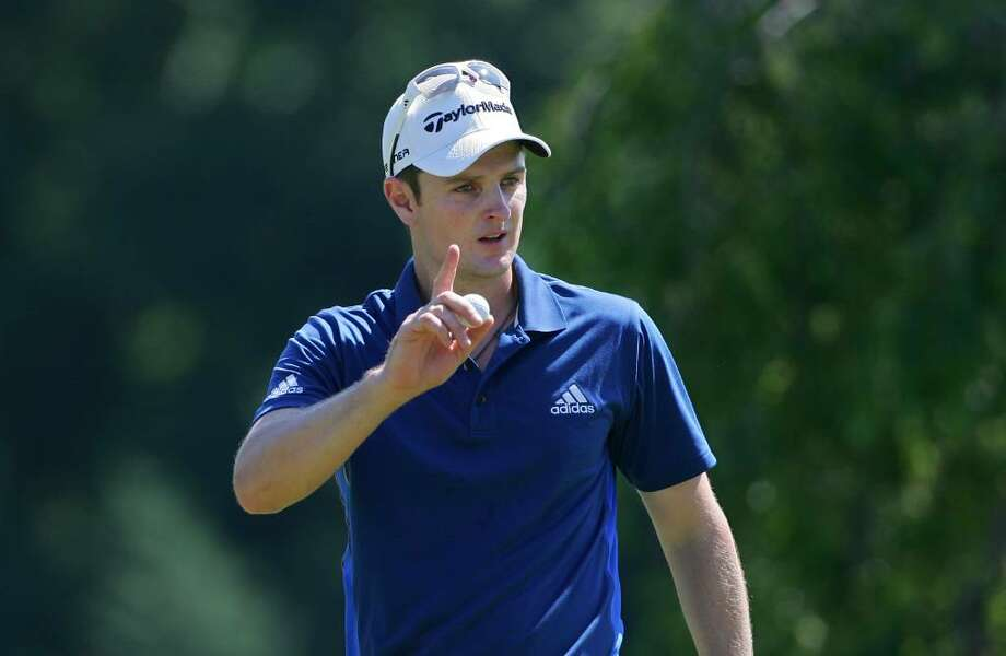 CROMWELL, CT - JUNE 25:  Justin Rose of England celebrates a birdie on the second green during the second round of the Travelers Championship held at TPC River Highlands on June 25, 2010 in Cromwell, Connecticut.  (Photo by Michael Cohen/Getty Images) *** Local Caption *** Justin Rose Photo: Michael Cohen, Getty Images / 2010 Getty Images