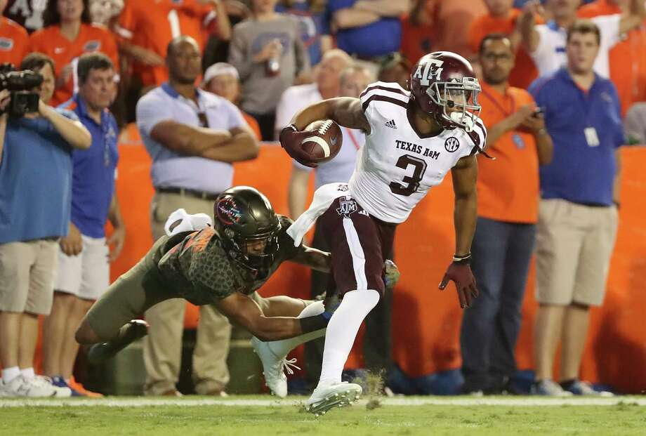 GAINESVILLE, FL - OCTOBER 14: Christian Kirk #3 of the Texas A&M Aggies rushes for yardage during the game against the Florida Gators at Ben Hill Griffin Stadium on October 14, 2017 in Gainesville, Florida.  (Photo by Sam Greenwood/Getty Images) Photo: Sam Greenwood, Staff / 2017 Getty Images