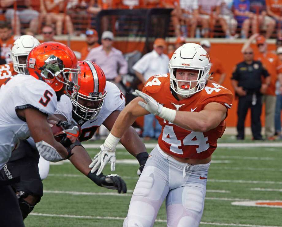 Texas linebacker Breckyn Hager (44) pursues Oklahoma State Justice Hill (5) during the first half of an NCAA college football game, Saturday, Oct. 21, 2017, in Austin, Texas. (AP Photo/Michael Thomas) Photo: Michael Thomas, FRE / FR65778 AP