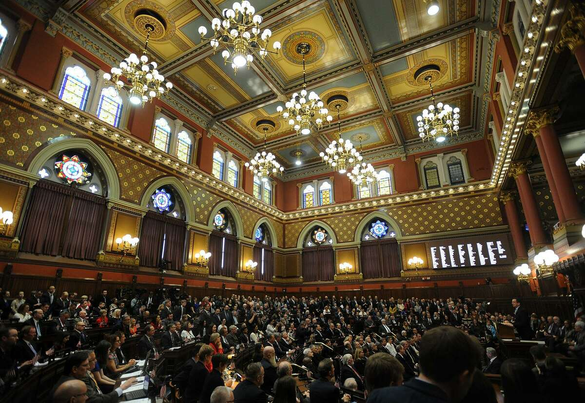 Gov. Dannel P. Malloy addresses a packed house chamber during opening day of the Legislature at the Capitol in Hartford, Conn. on Wednesday, January 4, 2017.