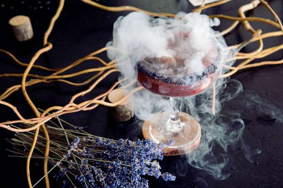 A Dark and Stormy cocktail made with gin, pomegranate juice and dry ice by Michelle Fitzgerald. Photo: Courtesy Michelle Fitzgerald