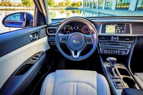 Standard Kia Optima Ex Hybrid Features Include Leather Seats Dual Zone Automatic Climate Control
