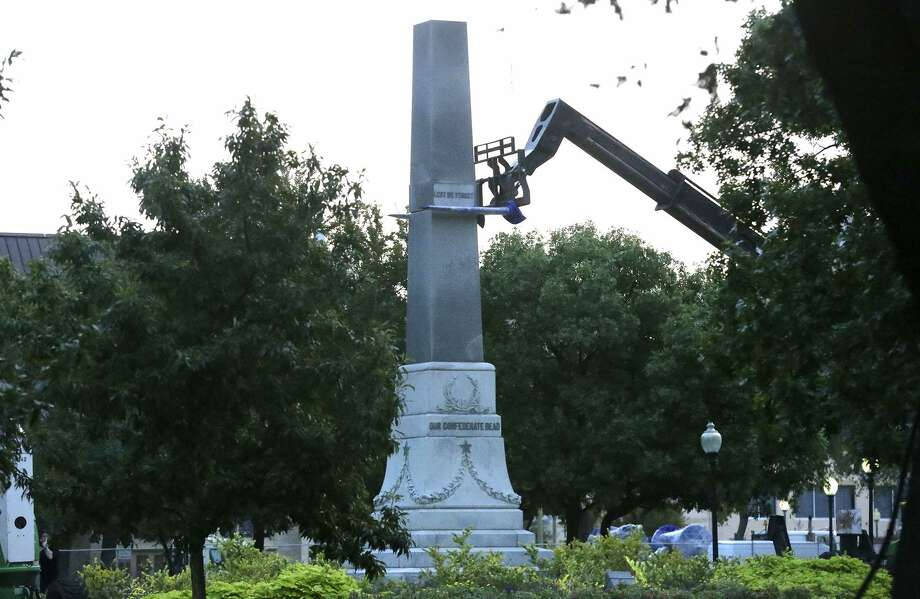 Crews work Friday September 1 , 2017 to remove the pedestal of the Confederate war memorial at Travis Park in San Antonio, Texas. The statue itself was removed earlier in the morning at about 2:00 a.m. and placed on a flatbed truck. San Antonio's City Council recently voted to have the memorial removed from the park. Photo: John Davenport, STAFF / San Antonio Express-News / ©John Davenport/San Antonio Express-News