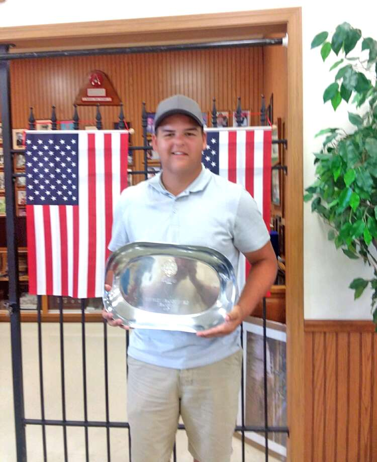 Garrett Helms, a 2017 Edwardsville High School graduate, poses with his trophy after taking first place overall in doubles at the Illinois state trap shooting championships, held in June at Brittany Shooting Park in Bunker Hill.