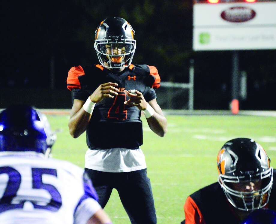 Edwardsville quarterback Kendall Abdur-Rahman awaits the snap during the second quarter of a game against Collinsville on Oct. 21 inside the District 7 Sports Complex at EHS.