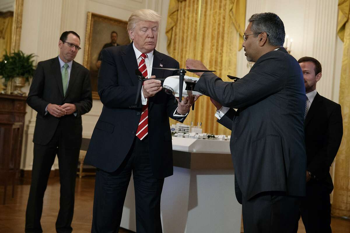 """George Mathew, CEO of Kespry, shows a drone to President Donald Trump during the """"American Leadership in Emerging Technology"""" event in the East Room of the White House, Thursday, June 22, 2017, in Washington. (AP Photo/Evan Vucci)"""