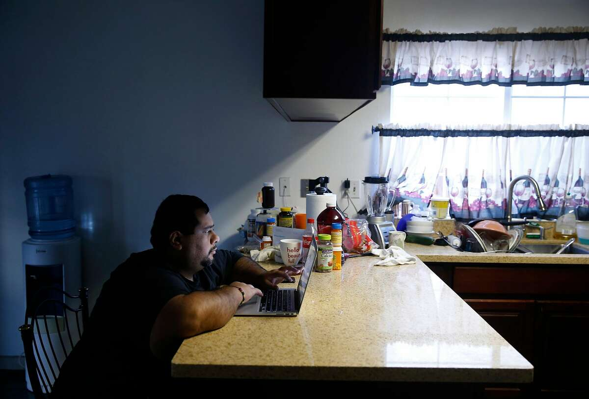 Omar Medina, a local organizer working on behalf of the immigrant community, works out the kitchen of his home in Santa Rosa, Calif. on Wednesday Oct. 25, 2017. Many undocumented residents affected by the wildfires are reluctant to file for FEMA claims fearing their status may be passed on to the Department of Homeland Security.