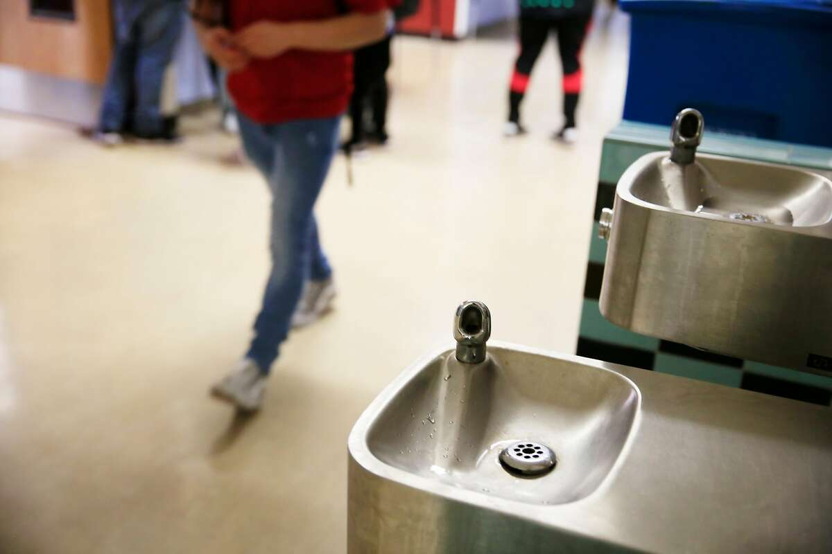 Students walk by a water fountain that was cleared for use at San Francisco International High School� on Wednesday, October 25, 2017 in San Francisco, Calif.