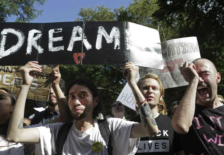 Protesters opposing President Donald Trumps plan to repeal the Deferred Action for Childhood Arrivals (DACA) program outside Trump International Hotel in New York, Sept. 9. There is a call on GOP Rep. Will Hurd of Texas' 23rd Congressional District to help Dreamers stay.