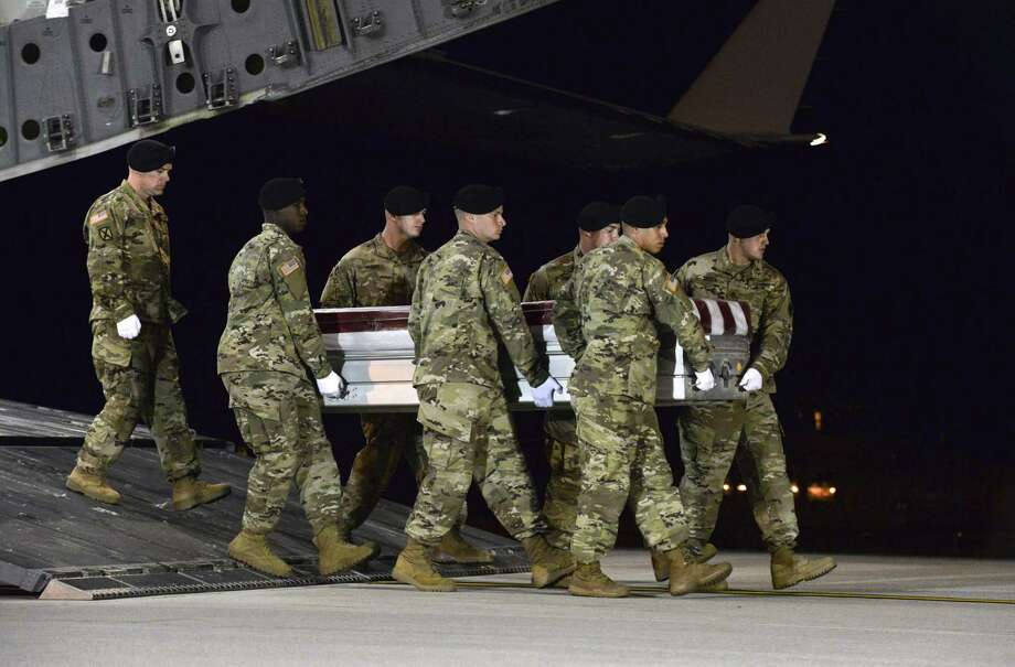 In a photo provided by the U.S. Air Force, the remains of Staff Sgt. Dustin Wright, one of four American soldiers killed in a firefight in Niger, is returned to Dover Air Force Base in Delaware, Oct. 5. The deaths prompt the question: What is the U.S. doing in Niger? Photo: US AIR FORCE /NYT / US AIR FORCE