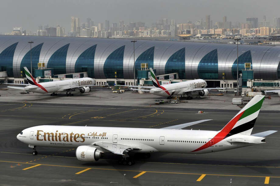 """An Emirates plane at Dubai International Airport. Emirates says it is starting new screening procedures for U.S.-bound passengers after receiving """"new security guidelines"""" from American authorities. Photo: Adam Scheck, STF / Copyright 2017 The Associated Press. All rights reserved."""