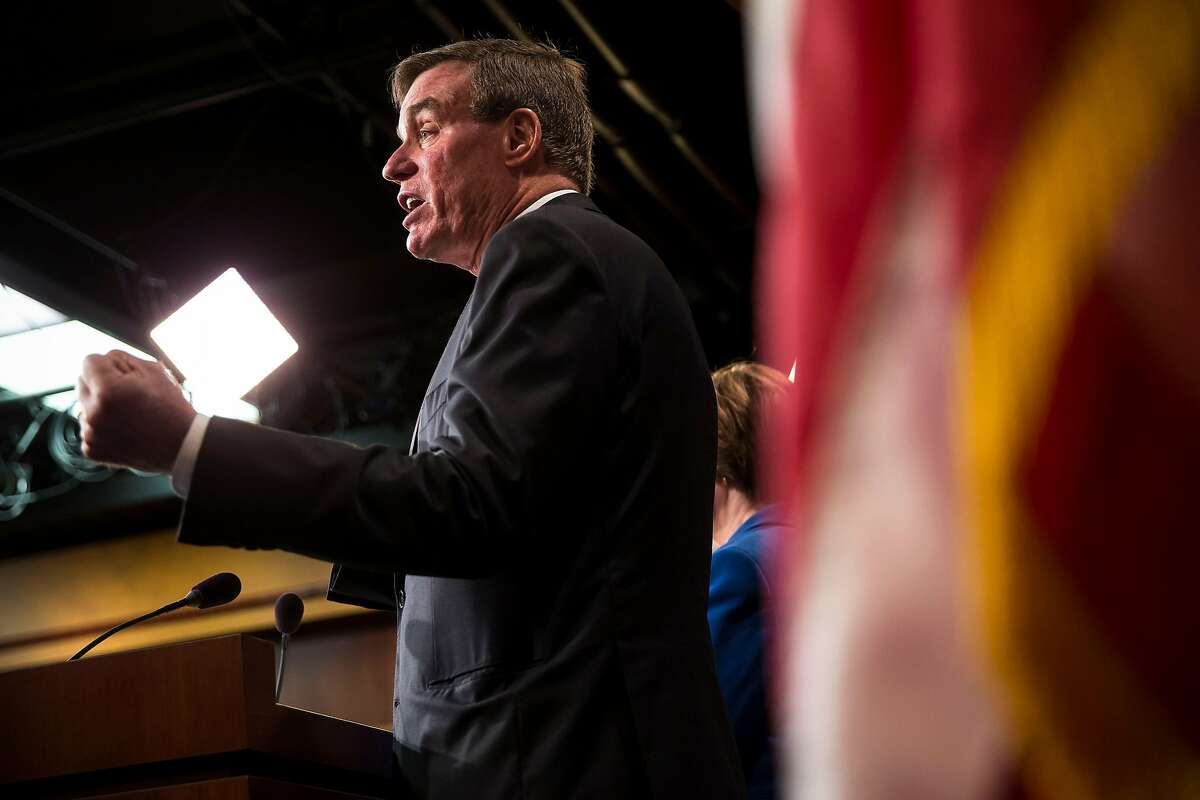Sen. Mark Warner (D-Va.), a sponsor of a bill that would require social media platforms to disclose the financing behind political ads, speaks about online political ads and preventing foreign interference in U.S. elections, during a news conference in Washington, Oct. 19, 2017. Lawmakers on Capitol Hill are pushing for regulations for technology companies for the first time in years, encouraged along by big tech�s broad assortment of rivals. (Al Drago/The New York Times)