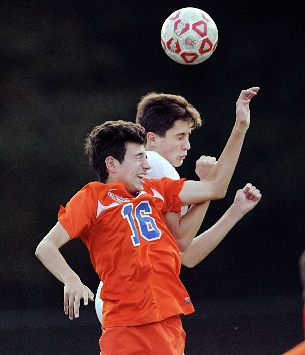 Danbury's Felipe Alves (#16), left, and Kai Lammers of Greenwich, top, go for the headers during the boys high school soccer match between Greenwich High School and Danbury High School at Cardinal Stadium in Greenwich, Conn., Tuesday night, Oct. 18, 2016. Greenwich won the match 5 - 0.