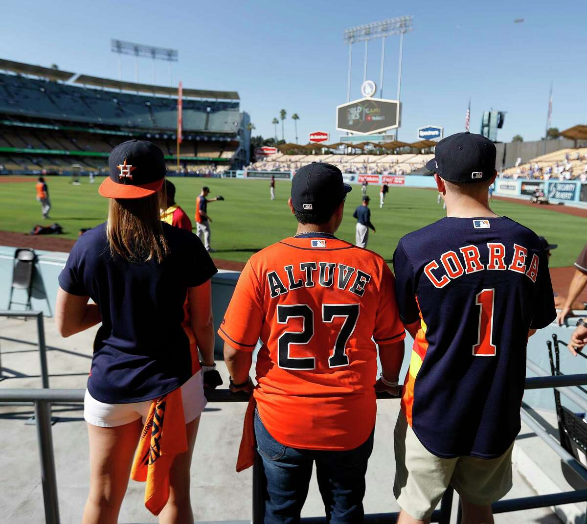 Houston Astros fans take in batting practice before the start of Game 2 of an MLB World Series at Dodger Stadium, Wednesday, Oct. 25, 2017, in Los Angeles.