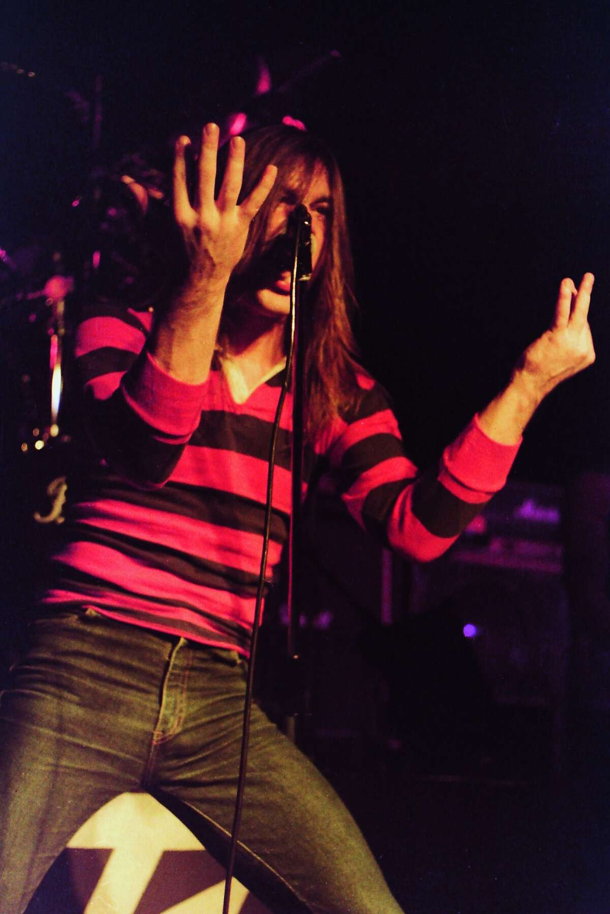 Long hair, stripes and jeans -- one uniform for heavy metal singers - as seen on Bruce Dickinson, who sang for Shots, Speed and Samson before joining Iron Maiden in the early 1980s. He's had a three-decade career with the band that included a short separation for several solo albums.
