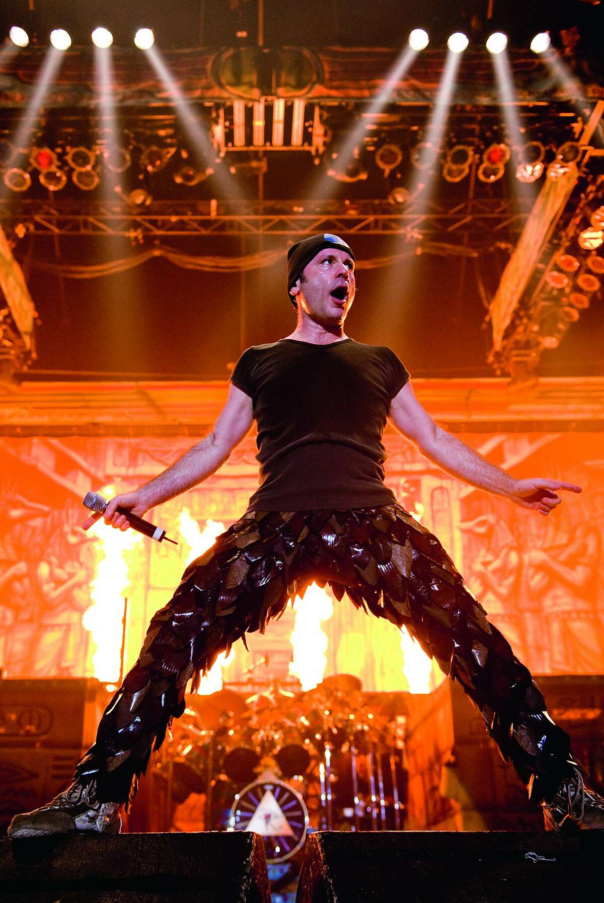 Bruce Dickinson, one of heavy metal's legendary singers and known for his operatic style and ear-splitting screams, is seen here in concert with Iron Maiden.