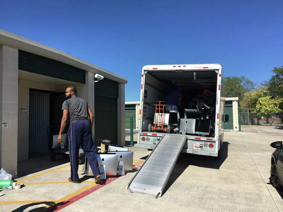 Computers, musical instruments and other property from the closed-down San Antonio School for Inquiry and Creativity — items that state officials had accused the school's former board president of stealing last August — are loaded on a truck Wednesday to be taken to charter schools hurt by Tropical Storm Harvey in Houston. Photo: /Staff