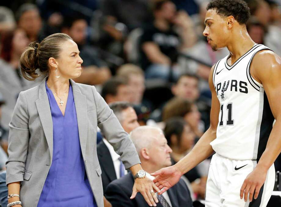 San Antonio Spurs assistant coach Becky Hammon greets Bryn Forbes as he walks to the bench during first half action of their preseason game against the Denver Nuggets Sunday Oct. 8, 2017 at the AT&T Center. Photo: Edward A. Ornelas, San Antonio Express-News / © 2017 San Antonio Express-News